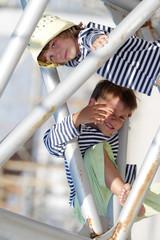 two happy children - kids - having fun outdoors