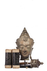 buddha head with sutra scroll and prayer wheel