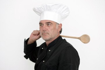 Koch mit Kochlöffel