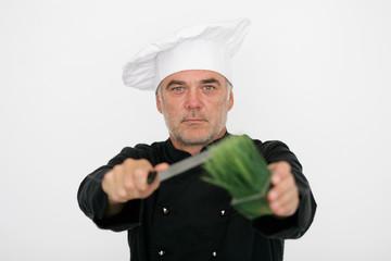 Koch mit frischen Kräutern