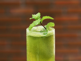 mint smoothie with lime in glass