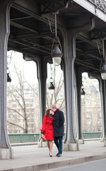 Romantic couple kissing on the Bir-Hakeim bridge in Paris