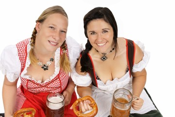 two pretty women in dirndls and pretzels