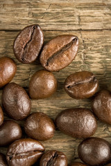 Coffee beans on the wooden vintage background