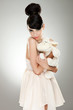 woman model hugging her fluffy sheep toy
