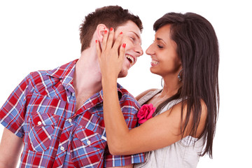 young couple smiling and preparing to kiss