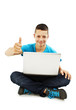Man with laptop showing thumbs up
