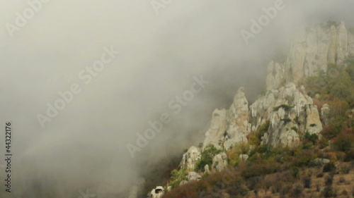 Time laps of Crimea mountains covered in fog