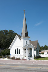Very small rural christian church with a steeple