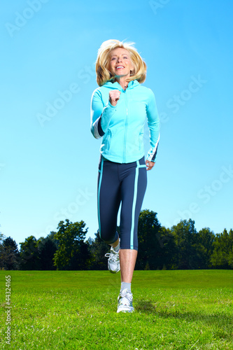 Happy jogging woman.