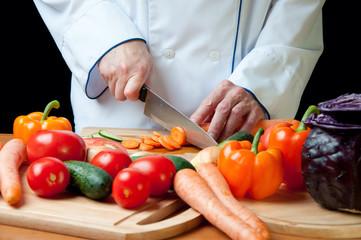 Chef chopping vegetables, horizontal shot