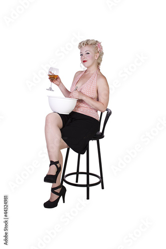 Sexy Retro Woman Cooking while Drinking
