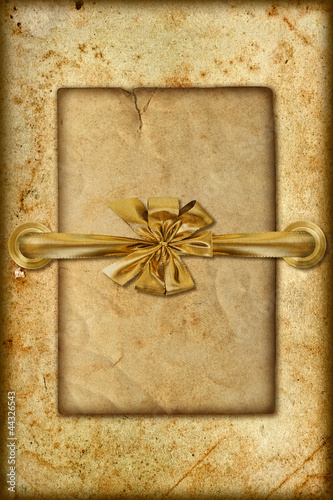 grungy card with golden ribbon