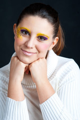 Portrait of beautiful smiling girl with leopard make up