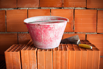 Trowel, bucket and bricks