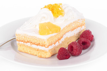 Cake with cream and raspberries.