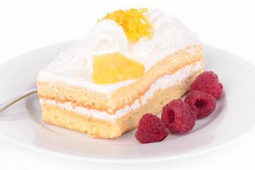 Cake with cream and raspberries.