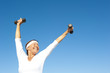 Active senior woman sky background