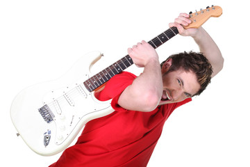 Aggressive young man about to smash his guitar
