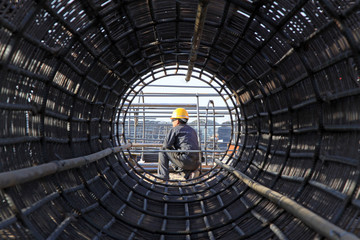 reinforced component at the construction site and workers
