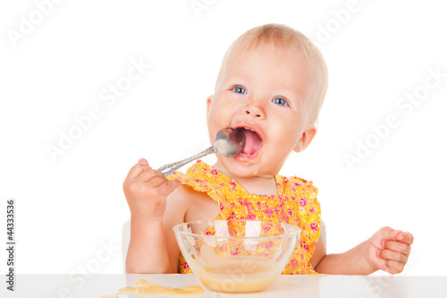 The little girl eats mashed