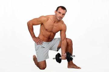 Man lifting dumbbell