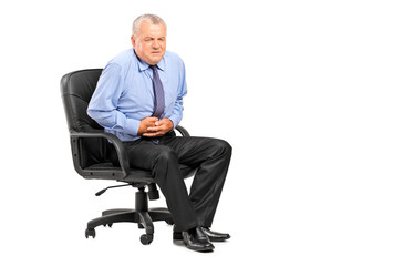 Businessman having a stomach ache