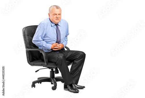 Businessman having a stomach ache