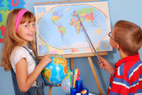 schoolgirl  and schoolboy on geography lesson poster