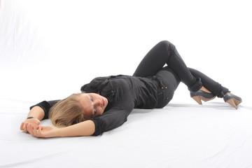 Blonde woman lying on white floor
