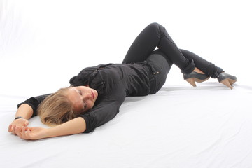 Blonde lying on white floor