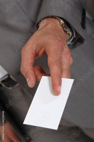 Executive handing out his business card