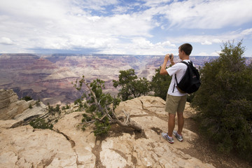 Boy taking picture at Grand Canyon