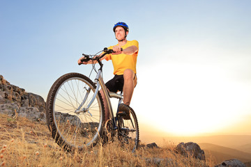 Person riding a mountain bike on a sunset
