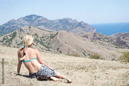 girl sitting and looking at the sea,  the mountains