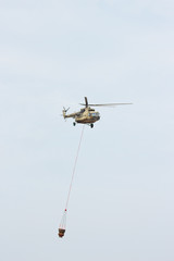 Russian military helicopter MI-8 extinguishes fire with water