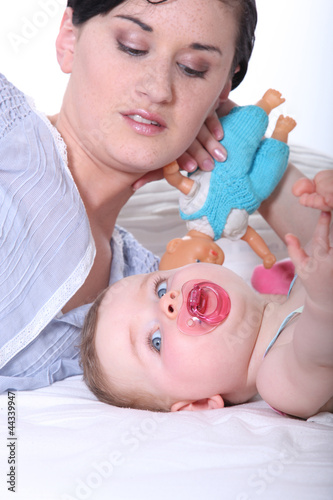 Woman playing with her baby