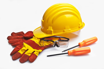 Yellow construction helmet and gloves isolated