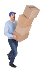 Young delivery man with falling boxes