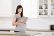 Pregnant Woman with Digital Tablet