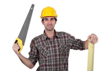 Carpenter holding hand saw