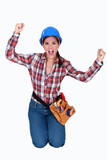 Triumphant female construction worker