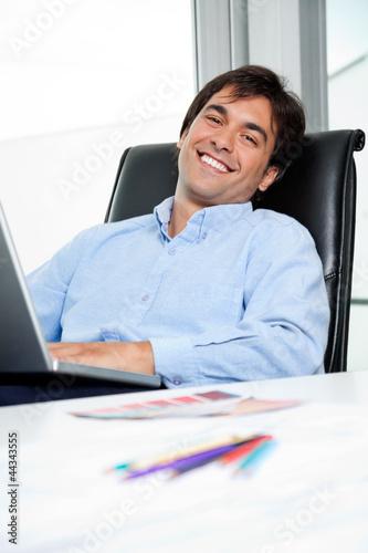 Interior Designer Using Laptop