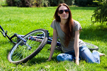 Woman with bike outdoors