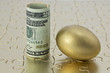Gold egg and dollar currency on puzzle
