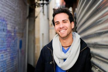 Portrait of handsome happy man in urban background