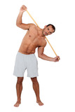 Man stretching using wooden pole