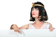Cleopatra pointing at blank advertising board