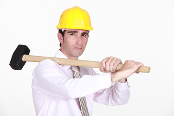 An architect with sledgehammer.