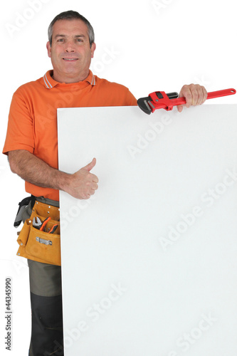 Plumber holding message board
